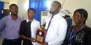student presenting gift